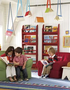 Books hanging from the ceiling is a great way to add pizzazz to your classroom!  Maybe even over a Reading Center?  Cute!