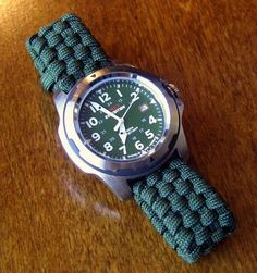 Adjustable Paracord Watchband...I made this adjustable paracord watchband with the similar weaving method to the paracord pouches/sheaths that I made, with the common basket weaving pattern. This example is just a rough draft and can use some tweaking to improve it, but I still like the overall outcome.