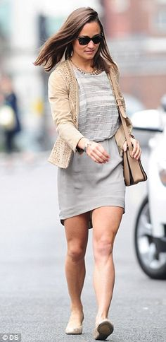 All business: Pippa chose a smart grey dress and a neat beige cardigan. September 2014.