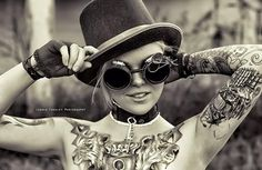 Steampunk tattoo girl - Steampunk comes from science fiction novels and evolves to a fashion style that mixes old and new and reproduces fashion elements with steampunk literature. As a form of artistic representation, it�s not surprised artists have found their way to apply the classic style in tattoo designs. Steampunk tattoos are loved by the people who want to add some retro-Victorian elements in their life.