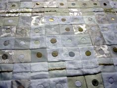 This post is a tutorial for a careful technique, reverse applique dots.  Two three inch squares are layered, basted together, and marked wi...