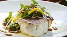 CORAL trout with green papaya, mango and Asian herb salad with peanuts and tamarind dressing.