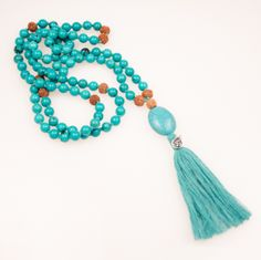Muse: heal, soothe, protect, take care, words that echo throughout our Heal mala of turquoise.     Mantra: I make peace with healing, it's an inside job.    Gemstone: turquoise    ​ Specifications: 108 beads with rudraksha markers, turqouise pendant with sterling silver OM charm on turquoise tassel        Relation: Heal Bracelet