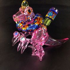 Instafire: Elbo and WJC Dino | This little bastard is just too damn cool looking. Don't even get me going on that kaleidoscope collar, you can thank WJC glass (@wjcglass) for that bit of swagga. His line and color work are absolutely phenomenal. It's so esoteric I'm surprised it doesn't give more people seizures like Pokemon.