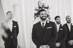 The groom's face when he sees his bride.