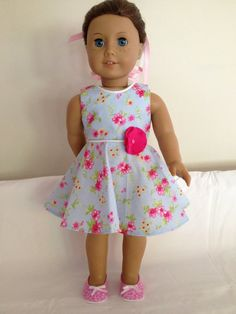 Blue and pink floral dress by LeslieNLaura. Made using the Versatility Dress pattern, found here http://www.pixiefaire.com/products/the-versatility-dress-18-doll-clothes. #pixiefaire #versatilitydress