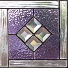 Stained glass panel with bevels in the center.
