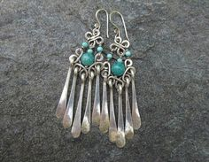 These elegant handcrafted earrings catch the light beautifully. They are about 2.5 inches long and are oxidized and polished to bring out the design