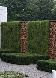 The trimmed box merge with the vertical garden.  Logs in between.
