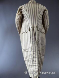 Rear view, fraque d'Incroyable, France, c. 1790-1805. Cream and purple striped silk taffeta, double-breasted with the original eight faceted buttons of polished steel, cream silk moiré lining.