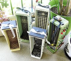 These are from etsy, but I love the idea of using the old sewing drawers for a jewelry holder