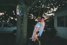 Always wanted a tire swing in the front yard. The setting and her smile only make me love this picture more