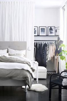 Getting a walk-in closet is easier than you might think. In this space, we moved the bed to the middle and lined one wall with clothes racks to create one.