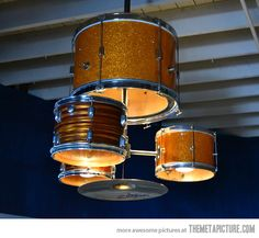 This is what Dad can do with his drums. Drum kit chandelier