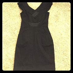 "Zara basic black dress Adorable Zara black dress, denim looking material, v-neck, some dark gray stitching giving nice lines, 2 front pockets, slit in rear. 32"" length. 97% cotton, 3% spandex Zara Dresses Mini"