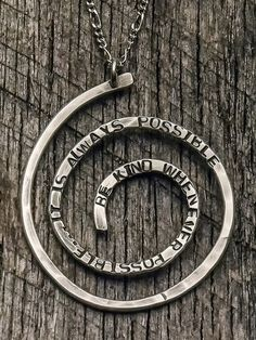 Silver spiral pendant with Mother Teresa quote: Be Kind Whenever Possible, It is Always Possible.