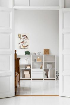 Beautiful white low Lundia shelves in white room
