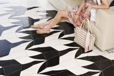 How to Decorate a Plywood Floor:  LOVE THIS IDEA! Inexpensive + Pretty. Love th eOut of the box thinking. Also, love the black and white floor.