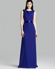 Sleeveless Blue Evening Gowns   #dress #gown #blue #bluedresses   This sapphire blue Armani Collezioni dress is retailing for $2325.  Our American company can recreate this for you for well under $1000. We specialize in affordable replicas and inexpensive custom evening gowns. For more info please go to www.dariuscordell.com