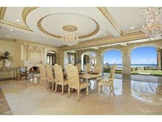For gracious entertaining the home provides a palatial formal dining room, grand European style ballroom with gorgeous chandeliers.