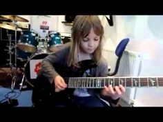8-year-old girl playing electric guitar is great! - YouTube