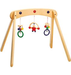 When you have a small home, so there is no place to hide the typical baby gear that tends to collect when you have a child. Here are twenty lovely wooden baby play gyms for every budget (and even a few DIY options! Natural Toys, Natural Baby, Organic Baby Toys, Newborn Toys, Newborns, Green Toys, Play Gym, Thing 1, Activity Toys