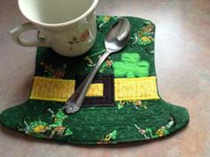 In the hoop Mug Rug from Beetle Bug Designs at http://beetlebugembroiderydesigns.com/index.php?main_page=product_info&cPath=1_3&products_id=11  You can find more at https://www.facebook.com/BeetleBugEmbroideryDesigns?ref=hl