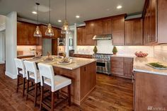 brown cabinets, clear lights, counters