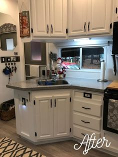 beautiful rv remodel - white cabinets with black hardware