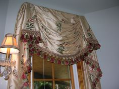 Powder room drapes. The window looks out on the front porch, just to the right of the front door, and I hoped the window treatment would provide something else to think about, and the blind that opens from bottom to top, which I couldn't get in the picture since the room is so small, would ensure privacy and some natural light.