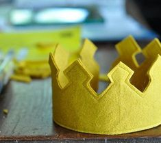 DIY Felt Crown for Dress Up. You'll Need: Wool felt, one inch elastic, gold thread, and free-printable crown template.