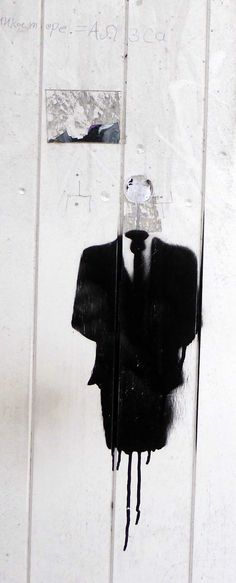 Streetart of a #man with suit but without head, seen in #Groningen #Netherlands