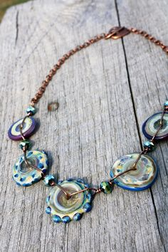 Glass Gypsy Necklace - Handmade Disc Lampwork Beads Copper Green Blue Purple. $32.00, via Etsy.