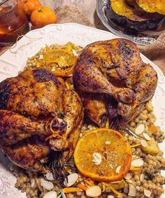 Harissa Cornish Hens stuffed with Dates and Clementines served over Moroccan Pearl Couscous.
