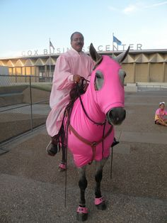 Tulsa District Judge James Caputo, wearing his pink robe and his horse to the square that marked the start of the third annual Legally Pink  ceremony. Approximately 400 people attended the early morning activity at the Aloft Hotel next to the Tulsa County Courthouse.