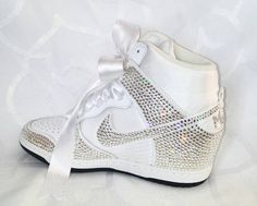 Check out this item in my Etsy shop https://www.etsy.com/listing/270138330/swarovski-wedding-shoes-bridal-sneakers