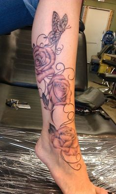 Vine roses with butterfly....leg tattoo