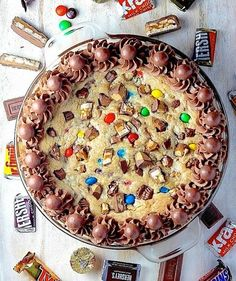 Instead of letting leftover candy sit and get stale (or gobbling it all up yourself), throw the tempting treats into a soft and chewy cookie cake. For an extra-sweet touch, pipe the edges with chocolate frosting, then garnish with Whoppers for a whimsical presentation.