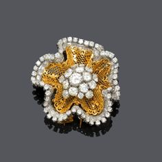 "DIAMOND FLOWER BROOCH, BY VAN CLEEF AND ARPELS, ca. 1950. Yellow gold 750 and platinum, 37g. ""Dentelle"" flower brooch, set with 16 circular- and brilliant-cut diamonds totalling ca. 4.70 ct, border set with 124 brilliant-cut diamonds weighing ca. 5.30 ct. Signed Van Cleef & Arpels, no. 3394CS. Ca. 4,5 x 4,5 cm."