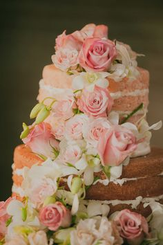 The wedding cake was a pink champagne naked cake adorned with fresh garden and spray roses and cascading orchids.