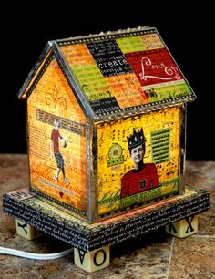 lighted mixed media>>made one these mixed media glass houses with Sally Jean Alexander