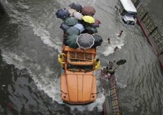 A truckload of stranded commuters crosses a flooded street in Manila on Aug. 19. Torrential rains brought the Philippine capital to a standstill, submerging some areas in waist-deep floodwaters and making streets impassable to vehicles.