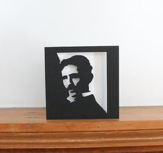 This a papercut portrait card of Nicola Tesla, the super geek of the 19th and 20th Century.    The card measures 5 wide by 5 high, cut in