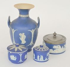 A 19th Century Wedgwood jasperware twin handled vase decorated with relief applied classical ladies against a lapis lazuli blue ground, height 27 together with a pewter lidded Adams box decorated with hunting scenes, a Wedgwood preserve pot with similar classical scenes and a lidded trinket box of cylindrical form with figures playing instruments and dancing, S/D to all