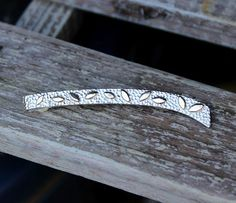 Silver tie pin with gold leafs
