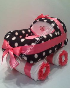 Carriage Diaper Cake #BabyShower gifts http://babyfavorsandgifts.com/hot-pink-and-black-carriage-diaper-cake-p-383.htm
