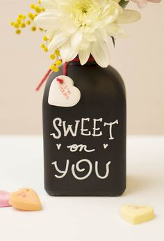 Our bud vase with chalkboard surface DIY is perfect to surprise your sweetie with flowers and just a teensy bit of candy for Valentine's Day.