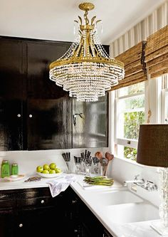 A crystal chandelier and high-gloss kitchen cabinets. The 100 year old restored farmhouse is the home of designer Tobi Tobin.