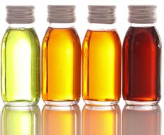 Therapeutic oils in beautiful clear bottles