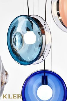 The ingenious design of Orbital collection's mouth-blown glass lenses, held together by a metal mounting, creates a fascinating visual experience from different angles. Glow Effect, Contemporary Pendant Lights, Lamp Bases, Glass Design, Hand Blown Glass, Pendant Lamp, Lighting Design, Bulb, Ceiling Lights
